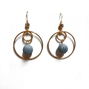 This product is a pair of Beautiful trendy ball earrings. It is purple in color.