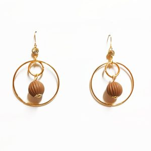 This product is a pair of Beautiful trendy ball earrings. It is golden in color.