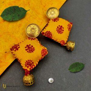 golden oxidised cloth earrings
