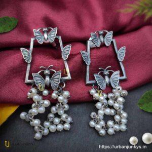 Silver lookalike butterfly pearl earrings